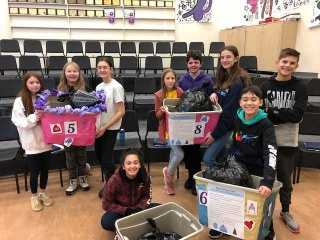 Middle schoolers pose with donations they gathered for the Giving Tree Project
