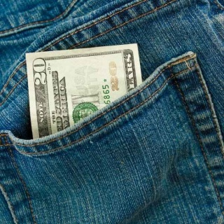 Closeup of twenty dollars in the back pocket of a pair of jeans