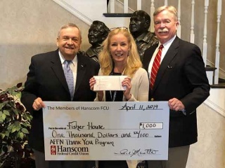 Paul Marotta Elizabeth St Pierre and David Sprague holding Fisher House big check