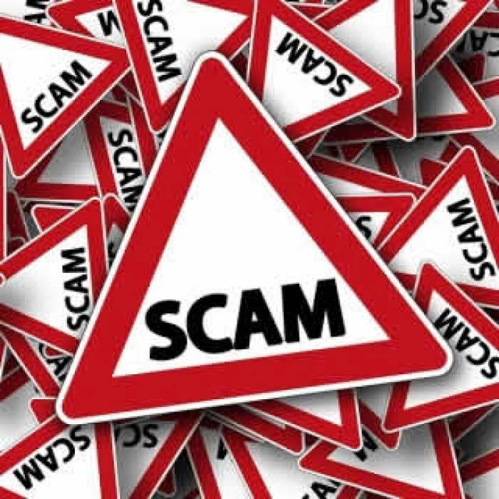 image of a sign that says scam