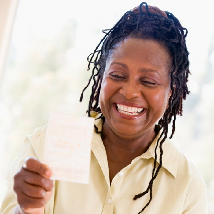 Woman-with-lottery-ticket